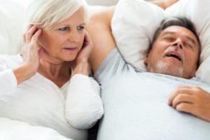 woman angry at husband snoring