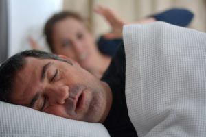 older man snoring while sleeping