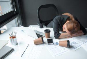 woman asleep at desk dealing with sleep apnea in Columbus
