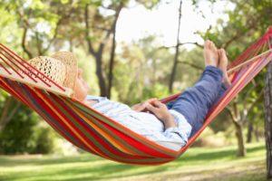 Man with sleep apnea in Columbus sleeping in a hammock