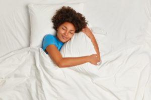 Woman with sleep apnea resting in bed