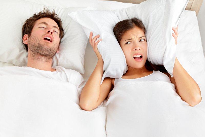 Man with sleep apnea sleeping next to partner