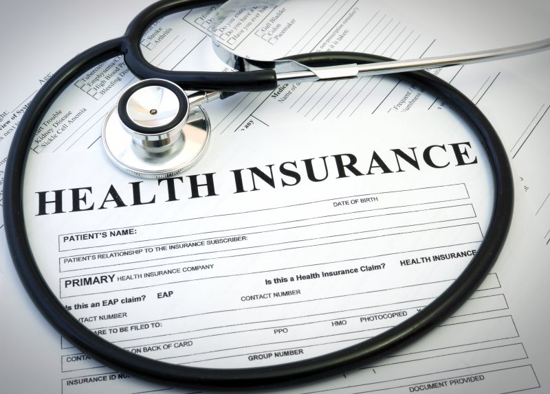 Stethoscope on top of a health insurance form